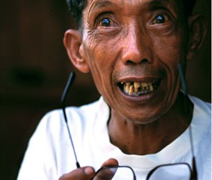 Duch confessing to mass murder after being confronted by photojournalist Nic Dunlop in Samlaut, Cambodia, in April 1999.