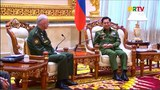 Russia's Deputy Defense Minister Alexander Fomin (L) meeting Myanmar armed forces chief Senior General Min Aung Hlaing in Naypyidaw,  March 27, 2021.