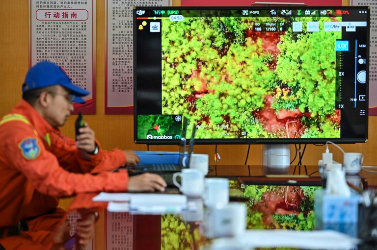 A member of the Yunnan Forest Brigade monitoring a herd of migrating elephants from the command center in Daqiao in southwest China's Yunnan province, July 23, 2021. Credit: AFP