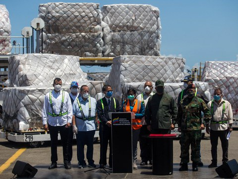Venezuela's Vice President Delcy Rodriguez (C) stands next to China's ambassador to Venezuela, Li Baorong (3rd L), and other Caracas officials on arrival of a 55-ton shipment of humanitarian aid and medical equipment sent from China for the fight against the COVID-19, at the Simon Bolivar Airport, March 28, 2020.