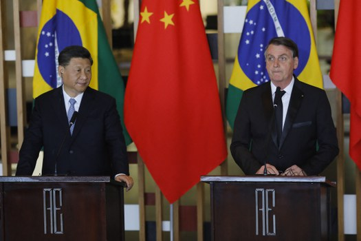 Chinese President Xi Jinping (L) and Brazilian President Jair Bolsonaro attend a press statement after their bilateral meeting at Itamaraty Palace in Brasilia, Brazil, on November 13, 2019. Credit: AFP