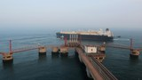 A liquified natural gas (LNG) tanker leaves the dock after discharge at PetroChina's receiving terminal in Dalian, Liaoning province, China July 16, 2018.