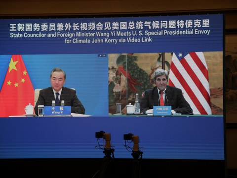 U.S. Special Presidential Envoy for Climate John Kerry is seen on a screen with Chinese State Councillor and Foreign Minister Wang Yi during a meeting via video link as Kerry visits Tianjin, China September 1, 2021.