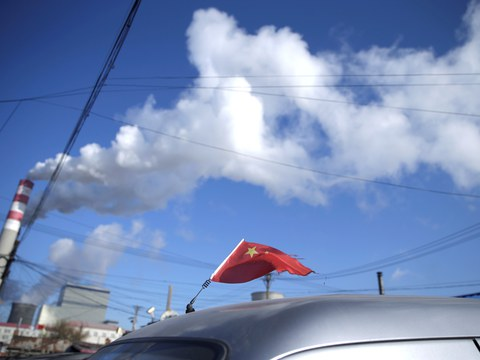A Chinese flag is seen on the top of a car near a coal-fired power plant in Harbin, Heilongjiang province, China November 27, 2019.