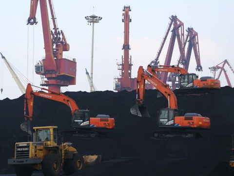 Workers unload imported coal at a port in Lianjungang in Jianxi province, China, Dec. 5, 2019.