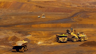 A truck is loaded with iron ore at the Christmas Creek iron ore mine located south of Port Hedland, Australia, in a file photo.