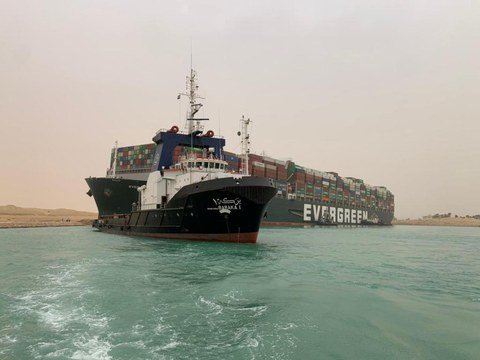 A container ship which was hit by strong wind and ran aground is pictured in Suez Canal, Egypt March 24, 2021. SUEZ CANAL