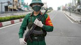 A Vietnamese soldier stands guard on a deserted road in Ho Chi Minh City, after the government imposed a stricter lockdown until Sept. 16 to stop the spread of the COVID-19 coronavirus, August 23, 2021.