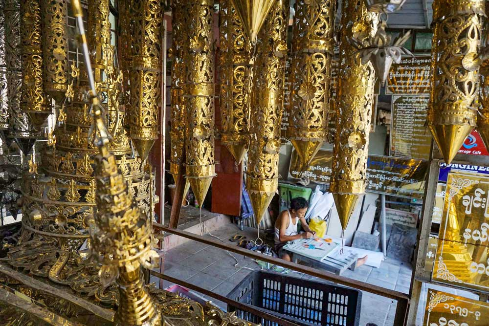 Pieces designed for pagodas hang in a shop waiting for a buyer. (Myo Min Soe/RFA)