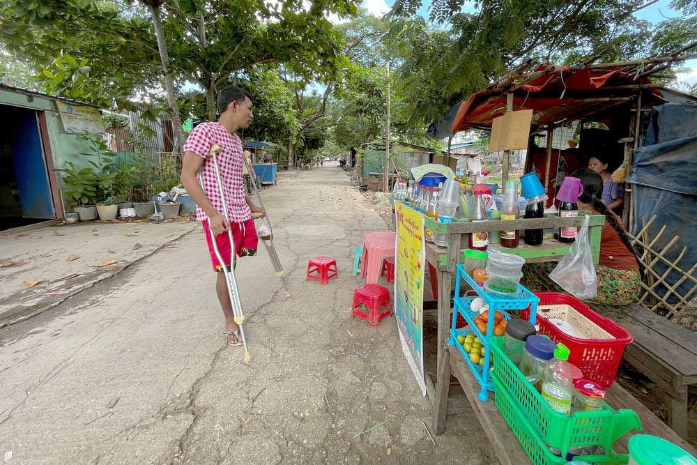 Ko Phyo looks to buy a toy for his son at a shop near his home. (REUTERS)