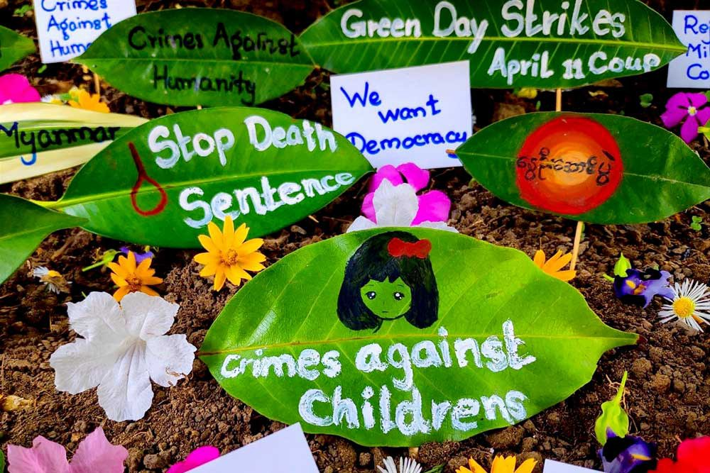 """Slogans and photos decorate leaves as part of a """"Green Day Strike"""" held this past week. (AFP/Anonymous source)"""