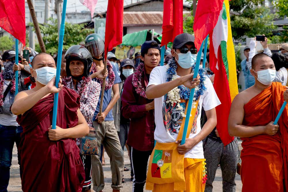 Buddhist monks and protesters march on Tuesday in Mandalay. (AFP/Anonymous source)
