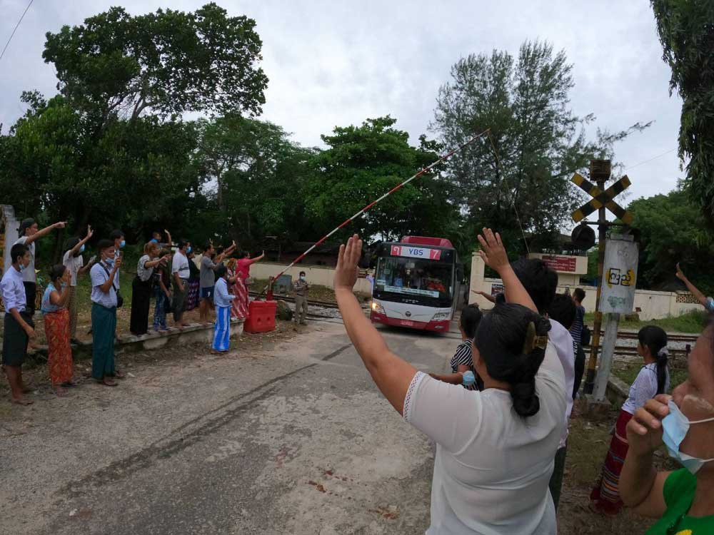 A bus with released prisoners onboard is driven out of Insein Prison in Yangon on Wednesday. (Myo Min Soe/RFA)