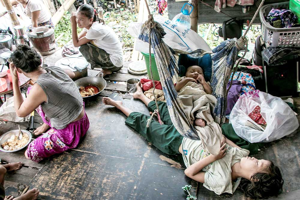 Children sleep in their home on the outskirts of Yangon.  (AFP)