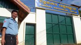 A guard stands outside the Kandal provincial prison in Cambodia in a file photo.