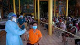 A woman receives China's Sinopharm COVID-19 coronavirus vaccine at a pagoda in Kandal province, June 10, 2021.