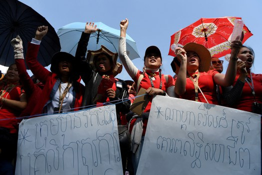 People shout slogans in front of NagaWorld hotel and casino during a protest in Phnom Penh, Jan. 10, 2020. AFP