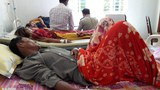 Patients sickened from drinking altered rice wine lie on beds at a hospital in Kratie province, Cambodia, May 6, 2018.
