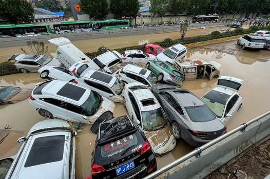 Cars sit in floodwaters after heavy rains hit the city of Zhengzhou in China's central Henan province, July 21, 2021. Credit: RFA