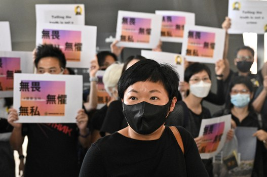 Radio Television Hong Kong (RTHK) producer Bao Choy Yuk-ling (C) arrives at the West Kowloon Courts building in Hong Kong on April 22, 2021, for charges she faced in connection with her research for a documentary on the Yuen Long attacks that took place in July 2019. Credit: AFP