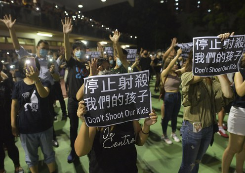 People gather to support an 18-year-old student who was shot in the chest by a policeman the day before during clashes between protesters and police in the Tsuen Wan area of Hong Kong, Oct. 2, 2019.