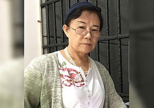 Chinese rights lawyer stands trial after four tears' pretrial detention