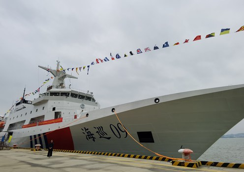 Caption: China's largest official law enforcement vessel Haixun 09 docks at a pier in Guangzhou City, Guangdong Province, Oct. 23, 2021.