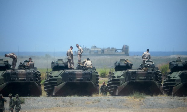 US Marines stand on their amphibious assault vehicles during annual US-Philippines military exercises, Zambales, Philippines, April 11, 2019.