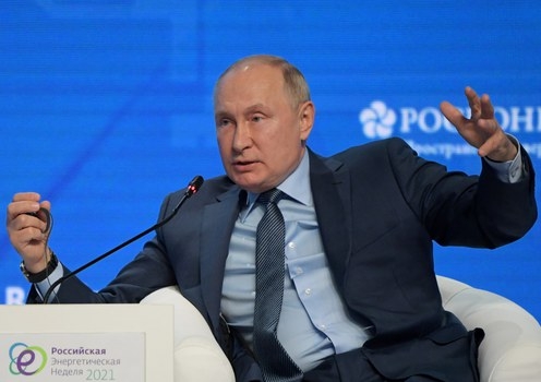 Russian President Vladimir Putin attends a plenary session of the Russia Energy Week International Forum in Moscow, Russia, Oct. 13, 2021..
