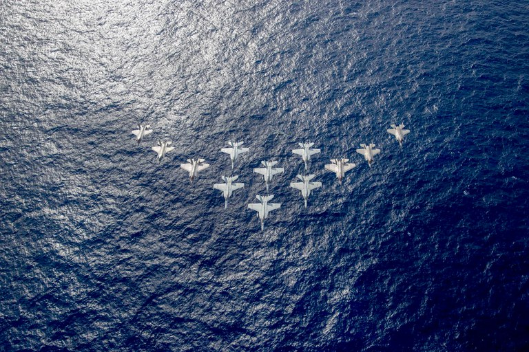 Aircraft from the United Kingdom's carrier strike group led by HMS Queen Elizabeth, and U.S. Navy carrier strike groups led by flagships USS Ronald Reagan and USS Carl Vinson fly in formation during carrier strike group operations in the Philippine Sea, Oct. 3, 2021. Credit: U.S. Navy