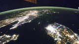 North Korea (the dark area) and South Korea at night are seen in an undated NASA handout picture from the International Space Station.