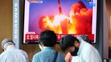 People watch a TV broadcasting file footage of a news report on North Korea firing what appeared to be a pair of ballistic missiles off its east coast, in Seoul, South Korea, September 15, 2021.