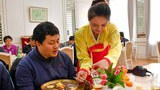 At the Okryu-gwan restaurant in Pyongyang, famous for its naengmyeon noodles, a waitress serves a customer while wearing traditional Korean clothing in this file photo.