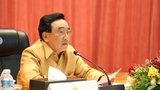 Lao Prime Minister Phankham Viphavanh addresses a meeting of state officials on July 6, 2021.