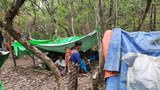 Villagers rest in makeshift tents after who fleeing fighting in Chin state's Thantlang township, June 11, 2021.