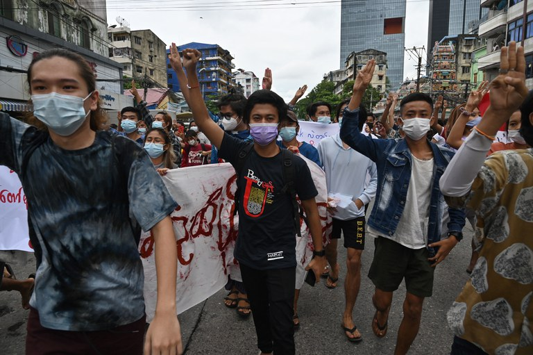 Protesters hold up a three-finger salute during a demonstration against the military coup in Yangon, July 11, 2021. AFP