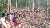 Refugees from fighting between Myanmar's military and Chinland Defense Force gather in a remote area of the western state which borders India and Bangladesh.