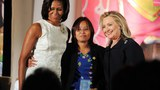 Zin Mar Aung, foreign minister of Myanmar's shadow government, poses with US First Lady Michelle Obama (L) and Secretary of State Hillary Clinton pose with r as she received  the 2012 International Women of Courage Award during a ceremony at the US State Department in Washington, DC, March 8, 2012.