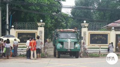 Visitors wait outside the gates of Insein Prison in Yangon, in an undated photo.