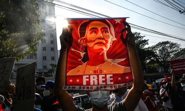A protester holds up a banner calling for the release from military custody of deposed Myanmar national leader Aung San Suu Kyi, Yangon, Myanmar, Feb. 15, 2021.