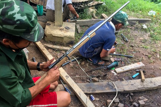 Members of the People's Defense Force (PDF) militia make handmade guns to be used in fighting against security forces in Kayah state, June 4, 2021. AFP