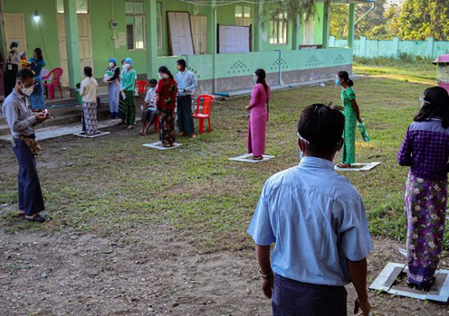 Voters queue up at a polling station in Rakhine state's Sittwe township, Nov. 8, 2020.