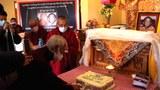 Thupten Tsewang, president of the Ladakh Buddhist Association, cuts a cake in celebration of the Panchen Lama's birthday, April 26, 2021.