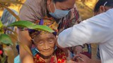 An elderly Tibetan receives a COVID-19 vaccination in Mainpat, a village in northern India's Chhattisgarh state, March 3, 2021.