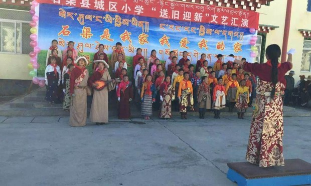 Tibetan children sing at a school in Sichuan's Sershul county in an undated photo.