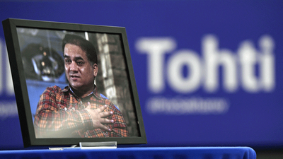 A framed photo of jailed Uyghur economist and human rights activist Ilham Tohti sits on a table during  the award ceremony for his 2019 Sakharov Prize at the European Parliament in Strasbourg, France, Dec. 18, 2019.