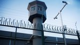 A guard tower rises along the perimeter fence of an internment camp in China's Xinjiang Uyghur Autonomous Region in a file photo.
