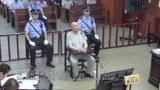 A screen shot of a video showing Memet Abdulla on trial in Urumqi in 2019.