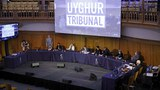 Members of the panel take their seats for the first day of hearings at the 'Uyghur Tribunal,'a panel of UK-based lawyers and rights experts investigating alleged abuses against Uyghurs in China, in London, June 4, 2021.