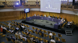 Geoffrey Nice (C), chairman of the Uyghur Tribunal,  gives the opening address on the first day of hearings investigating alleged abuses against Uyghurs in China, in London, June 4, 2021.